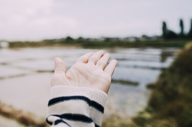France, Bretagne, Guerande, hand showing to saline - GEMF02447