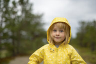 Norway, blond girl wearing rainjacket - PSIF00134