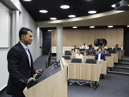 Man at lectern in lecture hall at Blavatnik School of Government - LUXF02294