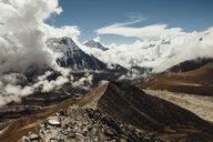Scenic view of mountains against cloudy sky at Sagarmatha National Park during sunny day - CAVF52369
