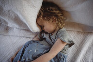 High angle view of cute girl sleeping on bed at home - CAVF52456