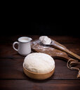 Close-up of fresh bread and flour on a table - INGF05471