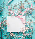 High angle view of a greeting card wrapped up in cherry blossoms - INGF05573