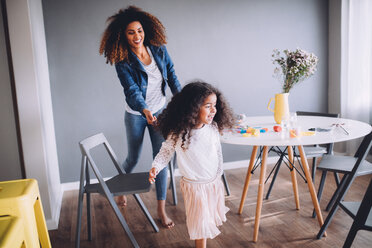 Mother and Daughter having fun at home. - INGF05594