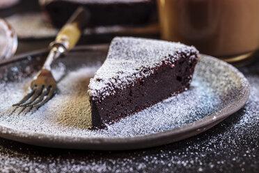 Swedish kladdkaka, dark chocolate cake, swedish brownie, with coffee, close-up - SBDF03807