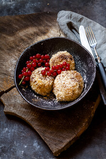 Plum filled sweet dumplings with coconut-cinnamon crust and redcurrants - SBDF03813