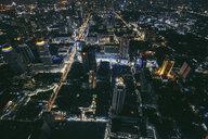Aerial view of illuminated cityscape at night - CAVF52925