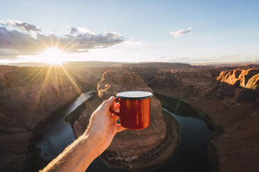 USA, Arizona, Colorado River, Horseshoe Bend, young man holding red cup - KKAF02849