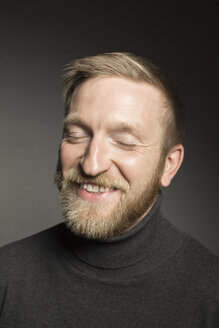 Portrait of smiling bearded man with eyes closed - VGF00088