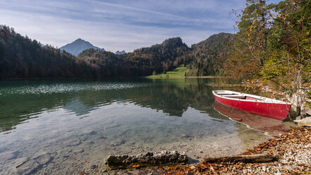 Germany, Bavaria, East Allgaeu, Fuessen, Alatsee, boat at lakeside in autumn - STSF01789