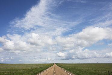 Open road through vast prairie and farmland, Saskatchewan, Canada. - MINF09285
