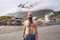 Norway, Lofoten, portrait of shirtless man with full beard - RSGF00059