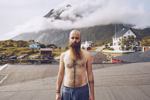 Norway, Lofoten, portrait of shirtless man with full beard - RSGF00059