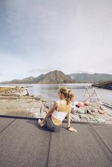 Norway, Lofoten, back view of woman looking at distance - RSGF00062
