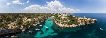 Spain, Balearic Islands, Mallorca, Llucmajor, Aerial view of bay of Cala Pi and Torre de Cala Pi - AMF06157