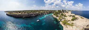 Spain, Balearic Islands, Mallorca, Llucmajor, Aerial view of bay of Cala Pi and Torre de Cala Pi - AMF06163