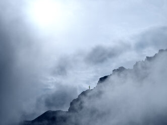 Border region Italy Switzerland, mountain landscape in clouds at Piz Umbrail - LAF02158