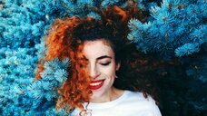 Young redhead woman and a blue tree - INGF06275