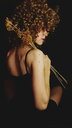 Back view of a woman with curly blonde hair - INGF06380