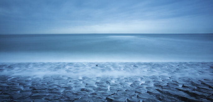 Beautiful scenic view of the blue sea on a stormy day - INGF06395