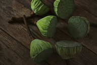 Close-up of fresh lotus pods on wooden table - CAVF53563