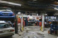 Cars in auto repair shop - CAVF53596