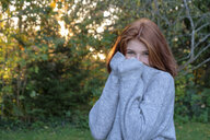Portrait of teenage girl wearing grey pullover in autumn - LBF02164