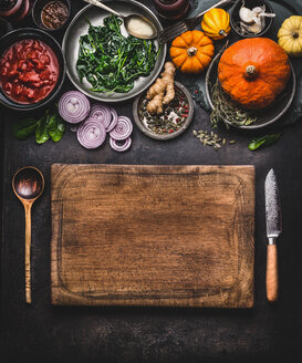 High angle view of fresh food and a chopping board on a table - INGF06555