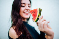 Young woman eating watermelon popsicle - INGF06627