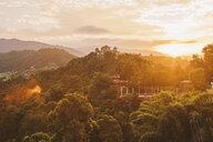 Mid distance view of Amitabha Monastery on mountain amidst trees against cloudy sky - CAVF53976