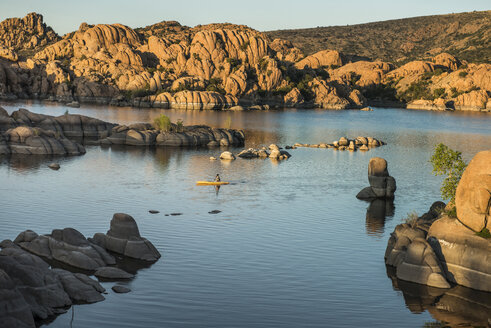 High angle view of man kayaking in Watson Lake against rock formations - CAVF53982
