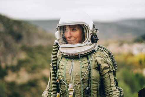 Portrait of woman in space suit exploring nature - OCMF00087
