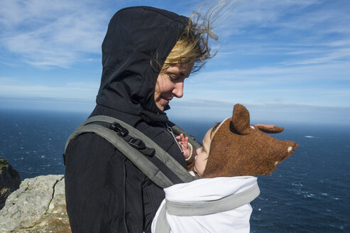 South Africa, Cape point, Mother with baby in baby carrier - RUNF00170