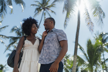 USA, Florida, Miami Beach, happy young couple at palm trees in summer - BOYF00782