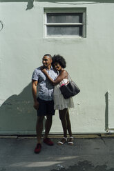 Smiling young couple standing at building - BOYF00788