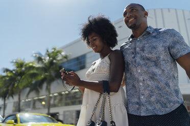 USA, Florida, Miami Beach, happy young couple on the move in the city - BOYF00836