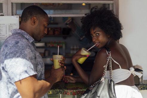 Young couple having a drink at a kiosk - BOYF00845