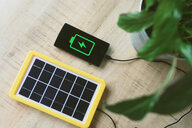 Renewable energy technology, solar panel charging a mobile phone battery - GEMF02492