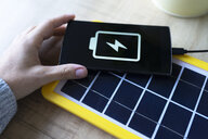 Renewable energy technology, solar panel charging a mobile phone battery - GEMF02495