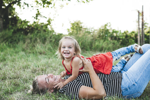 Portrait of happy girl with mother on meadow - HMEF00060