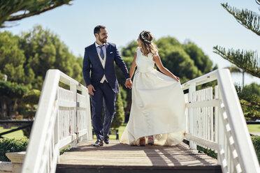 Bridal couple enjoying their wedding day in a park - JSMF00570
