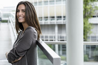 Smiling young businesswoman looking at distance - BMOF00071