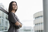 Portrait of young businesswoman looking at distance - BMOF00074
