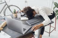 Tired freelancer sleeping on her deak - BOYF00941