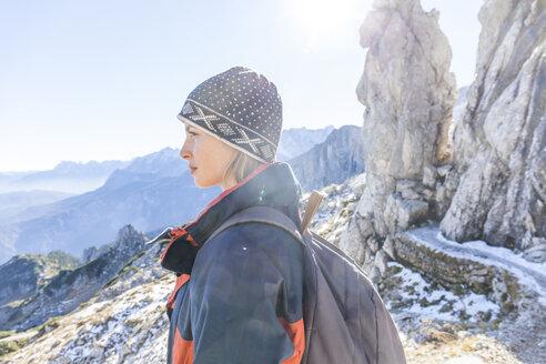Germany, Garmisch-Partenkirchen, Alpspitze, Osterfelderkopf, female hiker on viewpoint looking at view - TCF05925