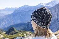Germany, Garmisch-Partenkirchen, Alpspitze, Osterfelderkopf, female hiker on viewpoint looking at view - TCF05937