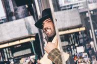 USA, New York City, portrait of bearded man with skateboard wearing black hat - OCMF00097
