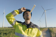 Portrait of an engineer with party blower at a wind farm - GUSF01322