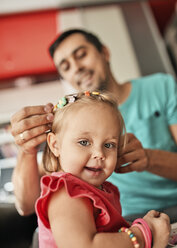 Portrait of smiling little girl with her father in the background - ZEDF01742