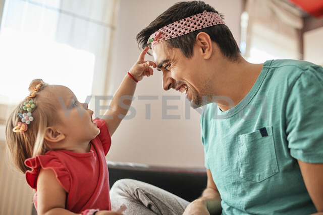 Father and little girl having fun together at home - ZEDF01745